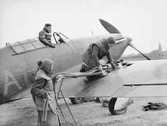 The Royal Air Force in France 1939 - 1940: A Hawker Hurricane fighter is loaded with ammunition before a mission., Devon S A (F/O)