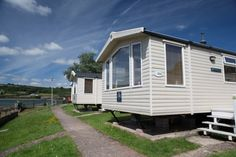 Otter Super Caravan - for 4 to 6 people Silver, extra wide, 2 bedroom caravan, with 1 double and 1 twin room + double sofa bed in lounge. PLUS: DVD player and balcony with outside seating. Most with stunning River Views. Devon Holidays, Twin Room, Outside Seating, Holiday Accommodation, Otters, Sofa Bed, Caravan, Recreational Vehicles, Balcony