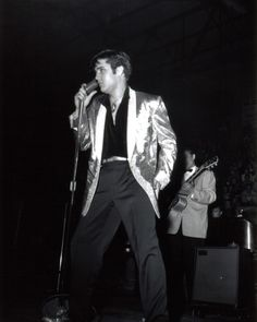 Elvis Presley on stage at Ottawa Auditorium , 3 April 1957.