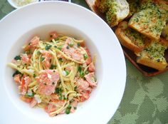 Easy to make smoked salmon pasta tossed with a light cream sauce, made complete with peas and a side of garlic bread