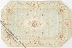 """Miniature 8 sided rug for your dollhouse. The unique shape of this rug is accented by it's traditional light green, ivory, and pale pink colours. The rug has a wide boarder with a cameo-like circle on each side of the rug. The centre features a geometric pattern with flowers in it.  Dimentions: 4-1/4"""" long x 2-3/4"""" wide."""
