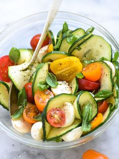 Inspiralized Caprese Zucchini Salad | foodeicrush.com Scroll way down for the recipe.