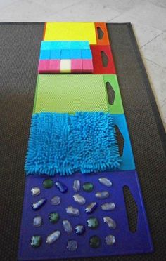 Awesome sensory activity for preschool or toddler kids. Make a sensory walkway!Tap the link to check out great fidgets and sensory toys. Check back often for sales and new items. Happy Hands make Happy People! Sensory Wall, Sensory Boards, Sensory Board For Babies, Diy Sensory Toys, Sensory Toys For Autism, Baby Sensory Play, Infant Activities, Preschool Activities, Senses Activities