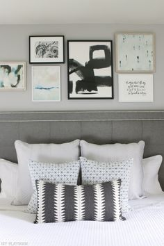 Adding a gallery wall over the bed draws the eyes up and makes the ceilings in a bedroom feel even taller. Love this idea to make a statement in your space with decor.