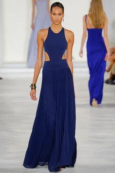 Ralph Lauren - Such a great collection - Blue cut out gown with pleated skirt paired with a gold cuff #SS16...x