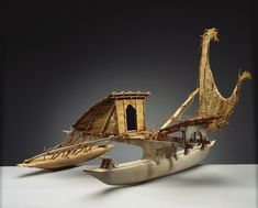 Outrigger boat (with two hulls), with pandanus hut and woven pandanus sail. Given to Queen Elizabeth from people of San Cristobal island