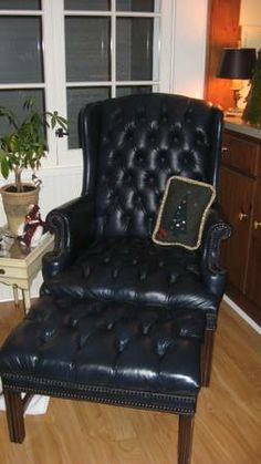 $150 navy leather tufted chair and ottoman