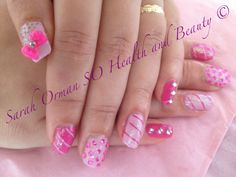 SO Health and Beauty 07429977674 Design by Sarah Orman, managing director of eastleigh based company between winchester and Southampton in Hampshire. Pink Brisa lite smoothing gel with a variety of beautiful shellac pink shades. Imbedded with heart shaped clear silver diamontees on the thumb nails and dark magenta diamontees on the well manicured fingers. 3d art using bright neon pink bow surrounded by nail art dotting pen in glitter gold. # Manicure naildesign nailart nail nails design art