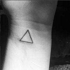 Wrist triangle tattoo.