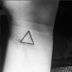 Wrist triangle tattoo.