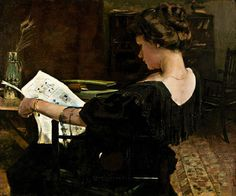 woman reading in black gown