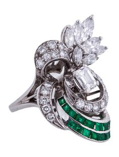Diamond and emerald set platinum cocktail ring.   <b> This item has been inspected and appraised by our certified gemologist. </b>  <b>Metal:</b> Platinum <b>Total Gram Weight:</b> 13.0   <b>Stones:</b> Diamond <b>Color: </b> H-I <b>Clarity: </b> VS1, VS2 <b>Total Carat Weight:</b> 2.00  <b>Stones:</b> Emerald <b>Color:</b> Green <b>Total Carat Weight:</b> 0.75