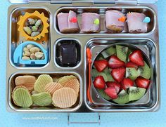 // ham & cheese rolls, nuts, veggie chips, strawberries and kiwi, organic dark chocolate