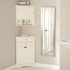 Cirrus Corner Wall Cabinet & Hamper - Convert that bare bathroom corner into a stage for style and storage with the Cirrus Corner Wall Cabinet & Hamper. Both items can be purchased sep...