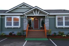 Charming and inviting porch on this manufactured home.  Factory Direct Homes