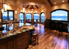 Love the finished wood floor, marble countertops, and open living room!
