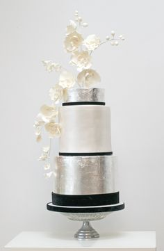 Silver Metallic Wedding Cake with Black and White Accents and Minimal Floral Topper