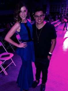 Oseas Villatoro and the founder of fashion week San Diego and she is wearing Oseas Villatoro blue gown