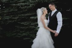 Matt Shumate Photography at Red Barn Farms wedding bride and groom portrait by evergreen trees