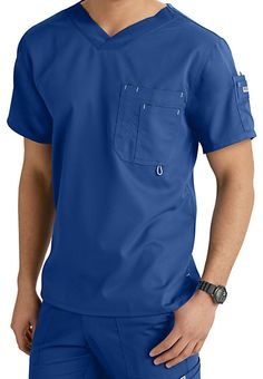 This Grey's Anatomy men's scrub top is made from the arcLux super soft and easy care fabric! It features a high, open V-neck with a slim silhouette and high-low hem. This 3-pocket top has a shoulder pocket and doubled chest pocket with a pen division and badge loop! Grey's Anatomy Men's 3 Pocket High V-neck Scrub TopsV-Neck 3 pockets Center back length: 30