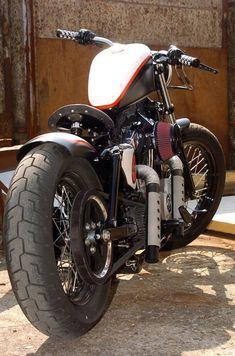 Sportster Harley Bobber RedStar Designed by Vida Loca Choppers in 2012 Sportster Cafe Racer, Sportster Iron, Harley Davidson Sportster 883, Harley Bobber, Bobber Motorcycle, Bobber Chopper, Motorcycle Design, Cool Motorcycles, Harley Davidson Motorcycles