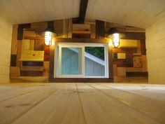 Love the wood wall and lights in the loft. Robins Nest Tiny House: Full Tour & Photos Photo
