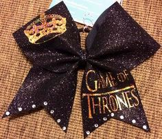 Bows by April - Game of Thrones Black Glitter and Gold Holo Cheer Bow, $19.00 (http://www.bowsbyapril.com/game-of-thrones-black-glitter-and-gold-holo-cheer-bow/)