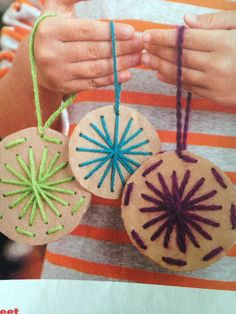 See Sweet-cut circles from cardboard, punch holes with a thick nail. Child can sew the design with yarn and plastic needle.