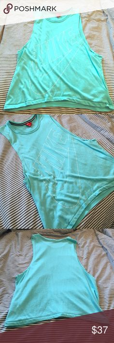 Nike Muscle Tee Bright Turquouse neon muscle tee!!!! Super cute and fun vibrant color. Very wide open armhole. Shows sports bra. Size S! Would also fit M. EUC really good condition ! Nike Tops Muscle Tees