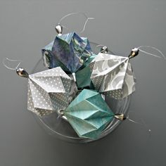 Make three kinds of pretty origami ornaments that aren't just for Christmas. DIY tips for success. Make three kinds of pretty origami ornaments that aren't just for Christmas. DIY tips for success. Origami Christmas Ornament, Origami Ornaments, Paper Ornaments, Christmas Paper, Ball Ornaments, Christmas Tree, Christmas Movies, Christmas Ideas, Diy Origami