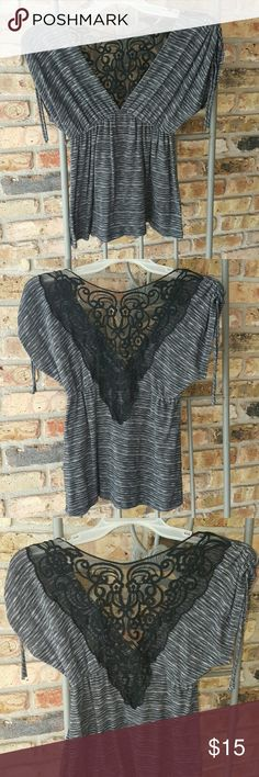 Wet Seal top Deep V neck. Need cami or tank underneath. Elastic around waist. Heather gray and black. Rouching pulls on sleeve shoulders. Gauzy decrotive V back panel. Gently used. Wet Seal Tops Blouses