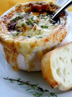 Vegetarian Onion Soup Serves 6. 3lb yellow onions, cut into 1/8-inch pieces 3T unsalted butter 1/2tsp salt, plus more as needed 1pinch sugar 8Cwater , plus more as needed 1T all-purpose flour 1sprig fresh thyme 1/4C dry white wine 1baguette , crusty 8ozGruyère cheese-I sliced it thick