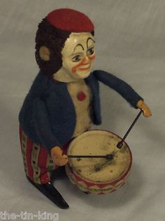 Schuco Clown Playing Drums