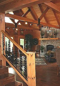 Alaska Dream Cabin Reddish brown heavy timber great room stone fireplace glass doors dark brownish r Timber Stair, Wrought Iron Stair Railing, Metal Railings, Mountain Home Interiors, Cabin Interiors, Log Cabin Homes, Log Cabins, Loft Railing, Fireplace Glass Doors