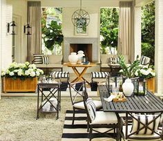 Hello happiness! What a classic, timeless outdoor lounge area that still has just the right amount of modern touches.