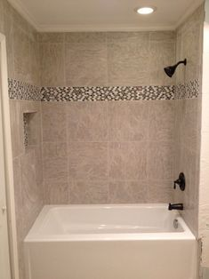 Tile & Bath tub Installation The Hamilton's called on Sless Construction to remodel the bathroom of their home in the Dommerich Hills area of Maitland, FL due to water damage from a plumb…