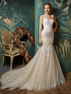 *NEW ARRIVAL* 'Jazzy', from the amazing new 2017 collection by Enzoani Blue. Stopping anyone in their tracks is easy in this gorgeous, full-length mermaid gown of exquisite Venice lace and tulle. A romantic sweetheart neckline is the perfect complement to a sultry low illusion back with crystal buttons along an invisible zipper - ensuring that your entrance will be just as showstopping as your exit. www.scarletpoppy.co.uk
