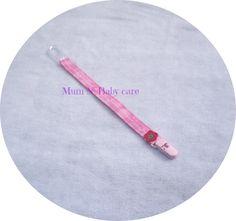 Fita para  prender a chupeta com mola em plástico rosa