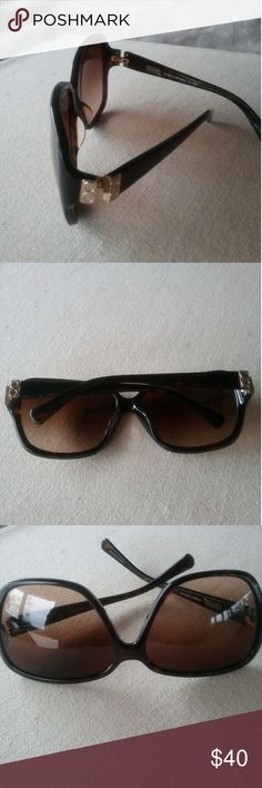 Coach  Bella Sunglasses Coach dark tortoise sung Asses HC8053/ L909 Bella with gold CC accents on arms  Still in good pre owned condition  LIGHT signs of use throughout frames Serial # 5001/ 13 dark tortoise 61 / 14 -125 - 3N Coach Accessories Glasses
