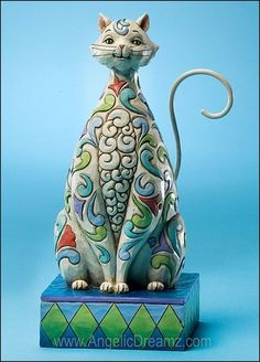 """Jim Shore Cats 2011  WINDSOR  This whimsical cat with its tulip patterning and curious smile is perfect for cat lovers.    Specifications:  Materials: Stone Resin   Size: 7.25""""H x 3""""W x 3.75""""L  Note: Unique variations should be expected; Hand painted.    Your Price: $31.00"""