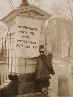 Women picketed the White House in 1917 to try to get President Wilson to support woman suffrage.