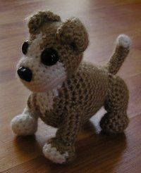 Free Amigurumi Patterns: Amigurumi Pitbull. Used it for a 2 headed dog. Modified the front legs to crochet leg and paw in one piece.