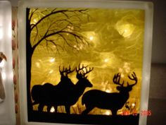 Made with glass block, paper and string of lights. Copper overlay would work.