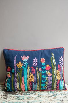 Perennials Embroidered Cotton Cushion Cover Our perennial flower cushion cover is blooming brilliance! Skillfully embroidered by master craftspeople, they use free hand machine embroidery to create this wild masterpiece.  Free hand machine embroidery Handmade by master craftspeople A fair trade company Skilled, artis