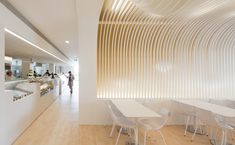 This bakery in Porto by Portuguese architect Paulo Merlini has a wavy ceiling that's designed to look like a dripping cake topping.