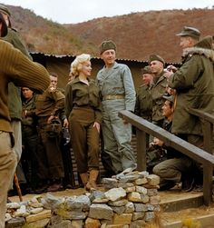Korea, 1954_FACT:Marilyn Monroe sings several songs for an estimated 13,000 men of the First Marine Division. Miss Monroe stopped by at the First Marine Regiment on her tour of the military units in Korea. February 16, 1954. Cpl. Kreplin { Marine Corps } ★ | marilynmtribute