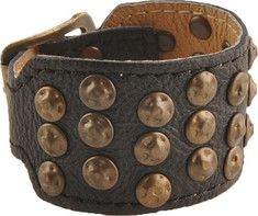 Rock, rivet, and roll. A cuff to be reckoned with bedecked in hammered, antique brass studs artfully arranged in sets of three. Three punches for the perfect fit.
