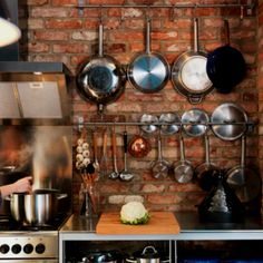 Pots and pans - exposed brick kitchen - FTW!