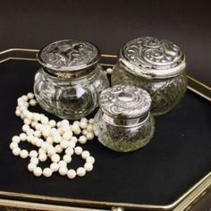Vintage glass pots with silver lids - the 2 on the right are avon though, I have a couple of these that were my moms.
