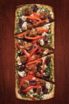 1 Flatout® Flatbread Artisan Thin Pizza Crust 1/2 cup cooked sausage, crumbled 1/3 cup pesto sauce 1/4 cup feta, crumbled 8 Kalamata olives, pitted and sliced 3 oz. sliced red peppers, sliced Place flatbread on a cookie sheet. Bake at 375 degrees for two minutes. Remove from oven. Spread pesto sauce on the flatbread. Top Continue Reading...